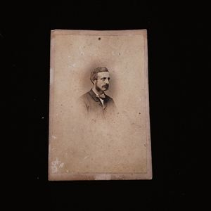 Victorian photograph of a mustachioed man.
